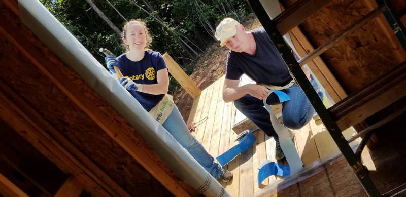 Julia and Dan help with a Habitat build